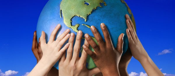 Children hands holding planet earth.